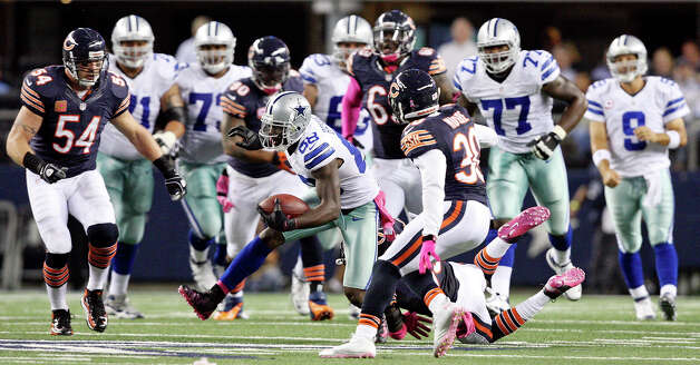 Dallas Cowboys' Dez Bryant looks for room around Chicago Bears' Charles Tillman and Chicago Bears' D.J. Moore during first half action Monday Oct. 1, 2012 at Cowboys Stadium in Arlington, Tx. Photo: Edward A. Ornelas, Express-News / © 2012 San Antonio Express-News