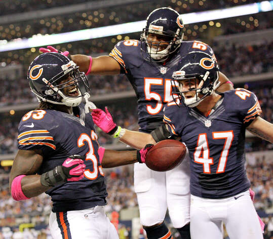 Chicago Bears' Charles Tillman (from left) is congratulated by teammates Chicago Bears' Lance Briggs and Chicago Bears' Chris Conte after scoring a touchdown on an interception against the Dallas Cowboys during first half action Monday Oct. 1, 2012 at Cowboys Stadium in Arlington, Tx. Photo: Edward A. Ornelas, Express-News / © 2012 San Antonio Express-News