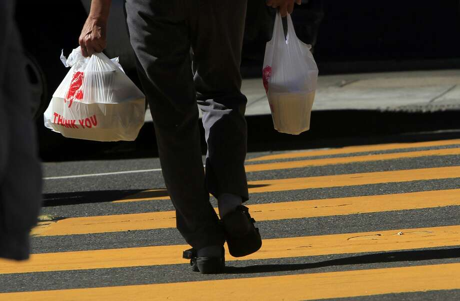 The law prohibits plastic bags that can be used only once and requires the stores to charge customers 10 cents for recyclable plastic or paper bags. Photo: Sarah Rice, Special To The Chronicle