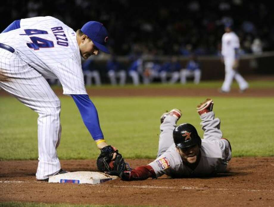 Jose Altuve of the Astros dives back into first base safely as Anthony Rizzo of the Cubs tags him in the fourth inning. (2012 Getty Images)