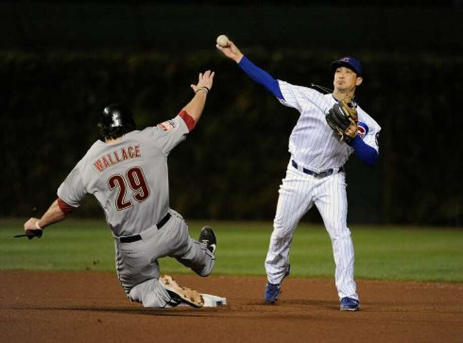 Darwin Barney of the Cubs forces out Brett Wallace in the seventh inning. (David Banks / 2012 Getty Images)