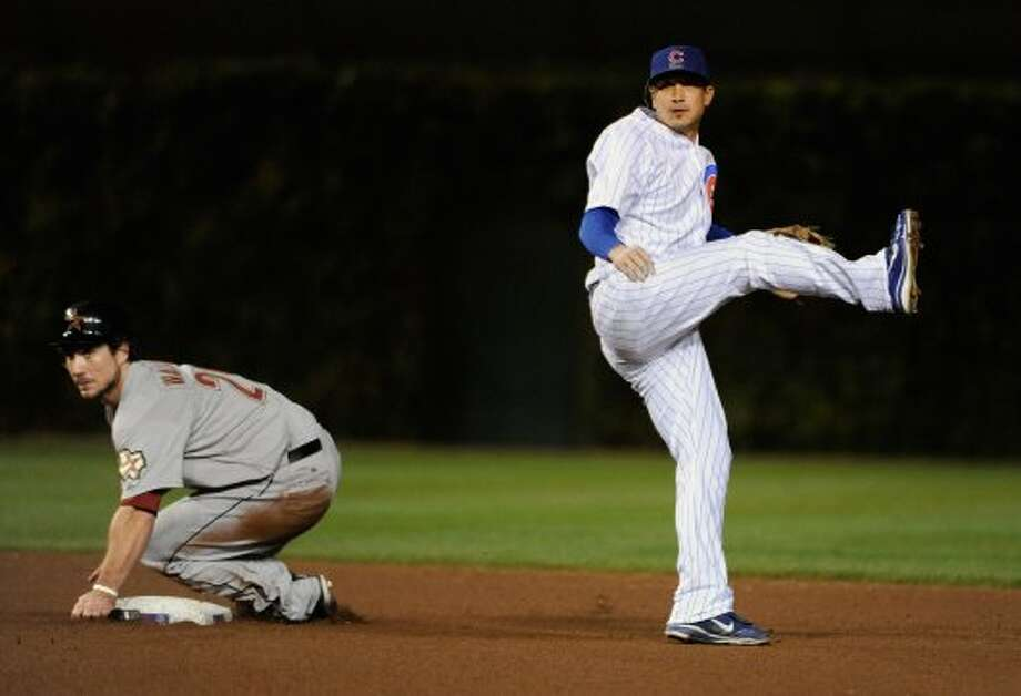 Darwin Barney of the Chicago Cubs forces out Brett Wallace in the seventh inning. (David Banks / 2012 Getty Images)