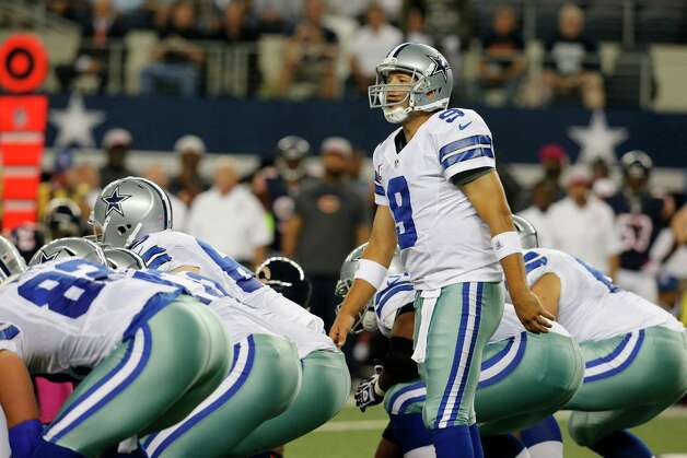 Dallas Cowboys' Tony Romo (9) at the line of scrimmage during an NFL football game against the Chicago Bears Monday, Oct. 1, 2012, in Arlington, Texas. (AP Photo/Sharon Ellman) Photo: Sharon Ellman, Associated Press / FR170032 AP