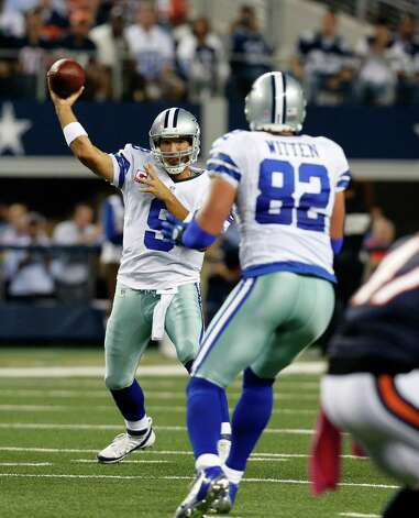 Dallas Cowboys quarterback Tony Romo (9) passes to Jason Witten (82) in the first half of an NFL football game against the Chicago Bears Monday, Oct. 1, 2012, in Arlington, Texas. (AP Photo/Sharon Ellman) Photo: Sharon Ellman, Associated Press / FR170032 AP