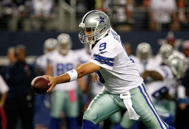 Dallas Cowboys' Tony Romo (9) drops back to hand off against the Chicago Bears an NFL football game Monday, Oct. 1, 2012, in Arlington, Texas. (AP Photo/Tony Gutierrez) Photo: Tony Gutierrez, Associated Press / AP