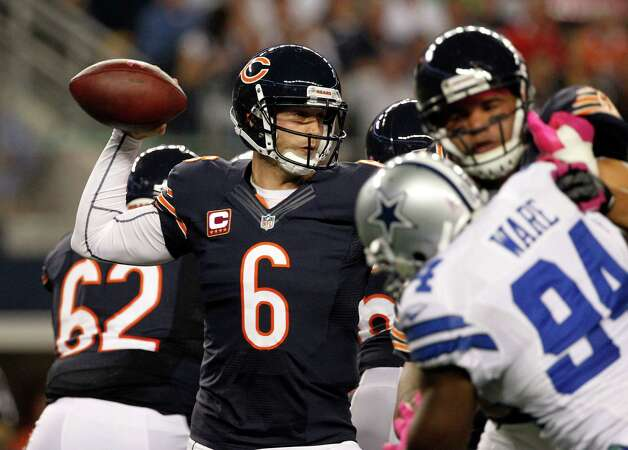 Chicago Bears quarterback Jay Cutler (6) passes as Dallas Cowboys' DeMarcus Ware (94) pressures during the first half of an NFL football game, Monday, Oct. 1, 2012 in Arlington, Texas. (AP Photo/Tony Gutierrez) Photo: Tony Gutierrez, Associated Press / AP