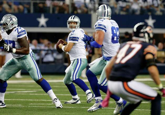 Dallas Cowboys quarterback Tony Romo (9) prepares to pass during an NFL football game against the Chicago Bears Monday, Oct. 1, 2012, in Arlington, Texas. (AP Photo/Sharon Ellman) Photo: Sharon Ellman, Associated Press / FR170032 AP