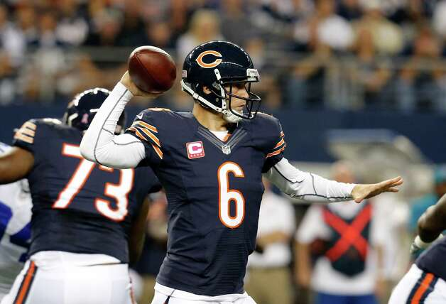 Chicago Bears' Jay Cutler (6) prepares to pass against the Dallas Cowboys in the first half of an NFL football game Monday, Oct. 1, 2012, in Arlington, Texas. (AP Photo/Sharon Ellman) Photo: Sharon Ellman, Associated Press / FR170032 AP