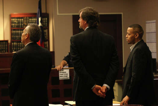 James Morrison, right, stands with his attorneys Joel Perez, left, and Mark McKay, as his capital murder trial gets underway in the Bexar County 379th District Court before Judge Ron Rangel, Monday, Oct. 1, 2012. Morrison, 33, is accused of shooting his ex-girlfriend, Candice Moten, who was five-months pregnant, her sister, Krystal Moten, 23, and their mother, Laura Moten, 46. Candice Moten was the only survivor of the April 2009 shootings outside their Northeast side apartment. Photo: Jerry Lara, San Antonio Express-News / © 2012 San Antonio Express-News
