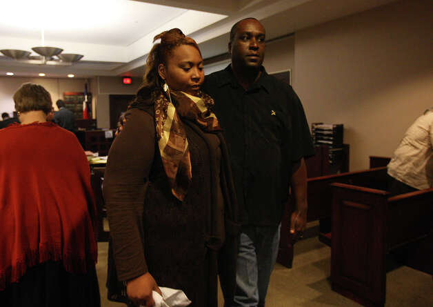 Candice Moten is escorted by her uncle Michael Moten, during a break in the capital murder trial of her former boyfriend, James Morrison, before Bexar County District 379th Judge Ron Rangel, Tuesday, Oct. 2, 2012. Morrison is accused of shooting Moten, her sister, Krystal Moten and their mother, Laura Moten at a Northeast side apartment complex in April of 2009. Candice Moten, who was 5-months pregnant with the suspect child at the time of the shooting, was the only survivor. Photo: Jerry Lara, San Antonio Express-News / San Antonio Express-News