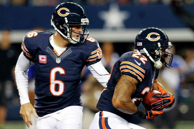 Chicago Bears' Jay Cutler (6) hands off to running back Matt Forte (22) in the first half of an NFL football game against the Dallas Cowboys, Monday, Oct. 1, 2012, in Arlington, Texas. (AP Photo/Sharon Ellman) Photo: Sharon Ellman, Associated Press / FR170032 AP