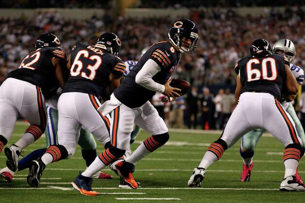 Chicago Bears' Jay Cutler (6) drops back against the Dallas Cowboys in an NFL football game Monday, Oct. 1, 2012, in Arlington, Texas. (AP Photo/LM Otero) Photo: LM Otero, Associated Press / AP