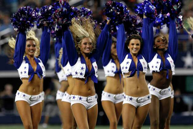 Members of the Dallas Cowboys cheerleaders perform before an NFL football game against the Chicago Bears Monday, Oct. 1, 2012, in Arlington, Texas. (AP Photo/LM Otero) Photo: LM Otero, Associated Press / AP