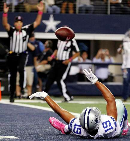 Dallas Cowboys wide receiver Miles Austin (19) celebrates after scoring a touchdown against the Chicago Bears during the first half of an NFL football game, Monday, Oct. 1, 2012, in Arlington, Texas. (AP Photo/LM Otero) Photo: LM Otero, Associated Press / AP