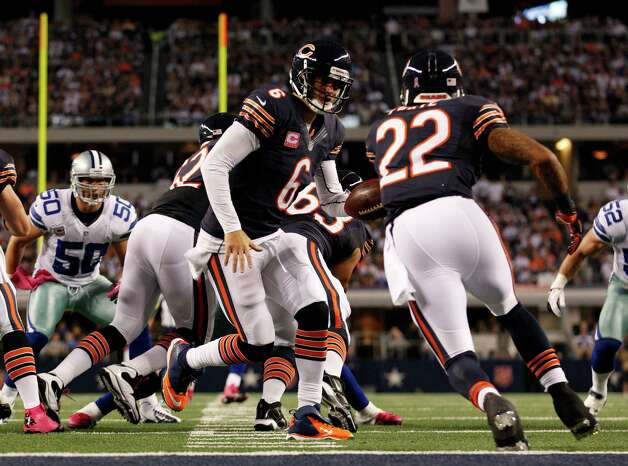 Chicago Bears' Jay Cutler (6) hands off to Matt Forte (22) during an NFL football game against the Dallas Cowboys  Monday, Oct. 1, 2012, in Arlington, Texas. (AP Photo/LM Otero) Photo: LM Otero, Associated Press / AP