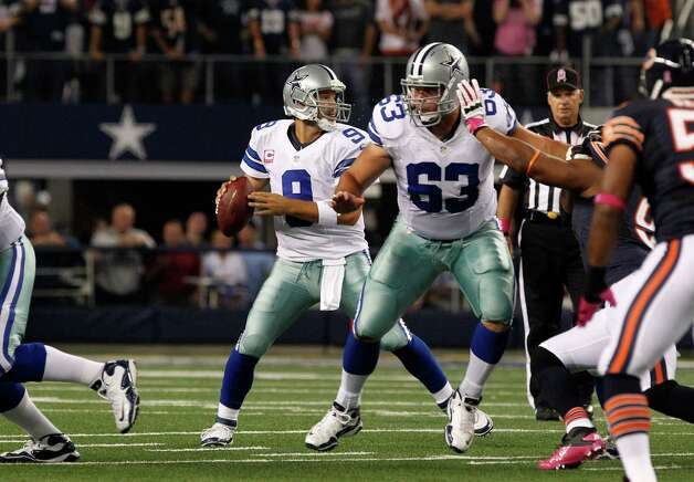 Dallas Cowboys center Ryan Cook (63) provides protection for quarterback Tony Romo (9) during an NFL football game against the Chicago Bears Monday, Oct. 1, 2012, in Arlington, Texas. (AP Photo/LM Otero) Photo: LM Otero, Associated Press / AP