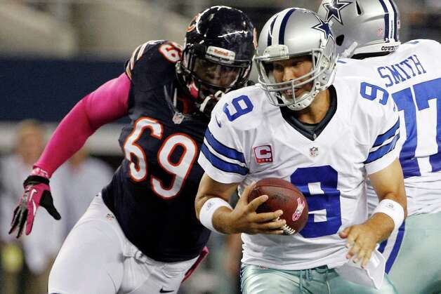Chicago Bears defensive tackle Henry Melton (69) moves in to sack Dallas Cowboys quarterback Tony Romo (9) during the first half of an NFL football game, Monday, Oct. 1, 2012, in Arlington, Texas. (AP Photo/Tony Gutierrez) Photo: Tony Gutierrez, Associated Press / AP