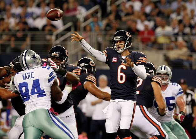 Chicago Bears' Jay Cutler (6) passes as Dallas Cowboys' DeMarcus Ware pressures in the first half of an NFL football game Monday, Oct. 1, 2012, in Arlington, Texas. (AP Photo/LM Otero) Photo: LM Otero, Associated Press / AP