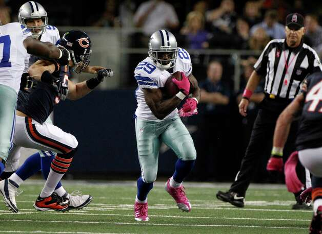 Dallas Cowboys' DeMarco Murray (29) finds a hole against the Chicago Bears in an NFL football game Monday, Oct. 1, 2012, in Arlington, Texas. (AP Photo/LM Otero) Photo: LM Otero, Associated Press / AP