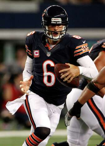 Chicago Bears' Jay Cutler (6) scrambles against the Dallas Cowboys an NFL football game Monday, Oct. 1, 2012, in Arlington, Texas. (AP Photo/LM Otero) Photo: LM Otero, Associated Press / AP