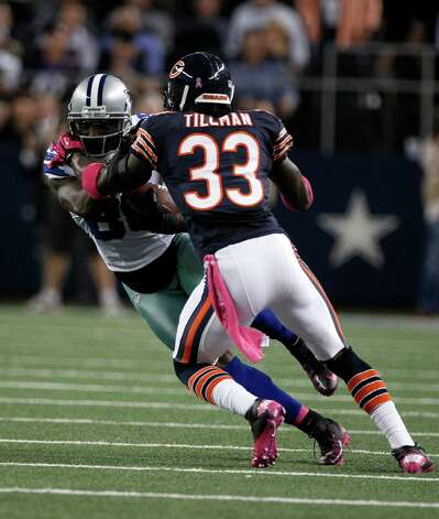 Chicago Bears cornerback Charles Tillman (33) attempts to bring down Dallas Cowboys' Dez Bryant (88) in the first half of an NFL football game Monday, Oct. 1, 2012, in Arlington, Texas. (AP Photo/LM Otero) Photo: LM Otero, Associated Press / AP