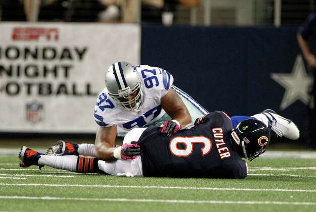 Chicago Bears' Jay Cutler (6) sacked by Dallas Cowboys' Jason Hatcher (97) in the first half of an NFL football game Monday, Oct. 1, 2012, in Arlington, Texas. (AP Photo/LM Otero) Photo: LM Otero, Associated Press / AP