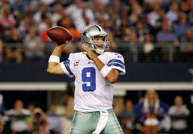 Dallas Cowboys' Tony Romo (9) prepares to pass during an NFL football game against the Chicago Bears Monday, Oct. 1, 2012, in Arlington, Texas. (AP Photo/LM Otero) Photo: LM Otero, Associated Press / AP