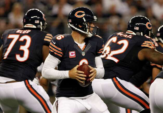 Chicago Bears' Jay Cutler (6) prepares to pass during the first half of an NFL football game against the Dallas Cowboys , Monday, Oct. 1, 2012 in Arlington, Texas. (AP Photo/Tony Gutierrez) Photo: Tony Gutierrez, Associated Press / AP