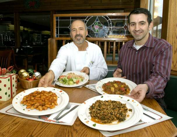 Peter Rountos, left, an owner of the Wind Mill Diner on Mill Plain Rd in Danbury and his nephew Stavros Mastrogiannis of Danbury, owner of Olympus Personal Training in Danbury. Mastrogiannis is a personal trainer who recommends a Mediterranean diet. Photo: Carol Kaliff / The News-Times