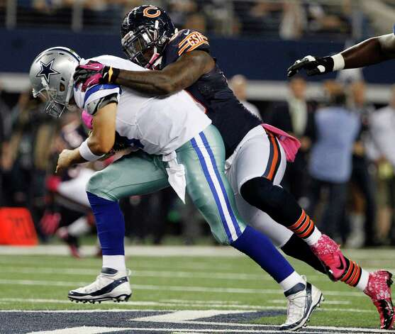 Chicago Bears defensive tackle Henry Melton (69) sacks Dallas Cowboys quarterback Tony Romo (9) during the first half of an NFL football game, Monday, Oct. 1, 2012, in Arlington, Texas. (AP Photo/Tony Gutierrez) Photo: Tony Gutierrez, Associated Press / AP