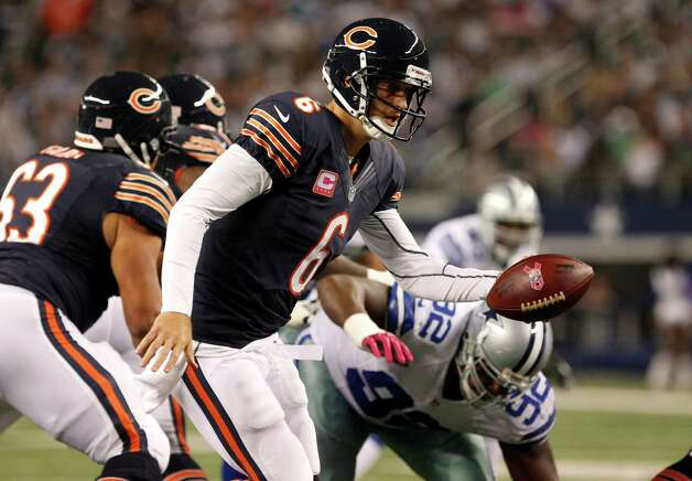 Chicago Bears quarterback Jay Cutler (6) drops back to hand off against the Dallas Cowboys in an NFL football game Monday, Oct. 1, 2012, in Arlington, Texas. (AP Photo/LM Otero) Photo: LM Otero, Associated Press / AP