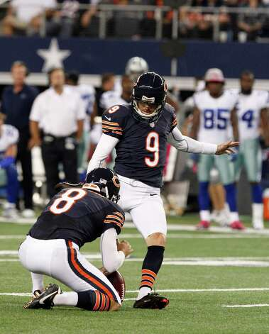 Chicago Bears' Robbie Gould (9) kicks a field goal as Adam Podlesh (8) holds the ball during an NFL football game against the Dallas Cowboys Monday, Oct. 1, 2012, in Arlington, Texas. (AP Photo/LM Otero) Photo: LM Otero, Associated Press / AP