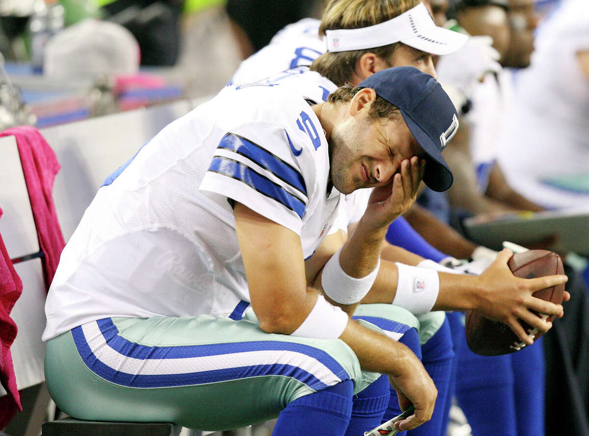 Oct. 1: Dallas Cowboys' Tony Romo sits dejected on the bench during second half action against the Chicago Bears at Cowboys Stadium. The Bears won 34-18.