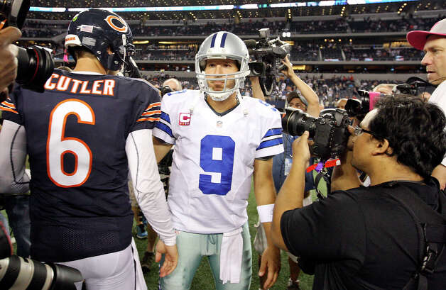 Chicago Bears' Jay Cutler and Dallas Cowboys' Tony Romo meet after the game Monday Oct. 1, 2012 at Cowboys Stadium in Arlington, Tx.  The Bears won 34-18. Photo: Edward A. Ornelas, Express-News / © 2012 San Antonio Express-News