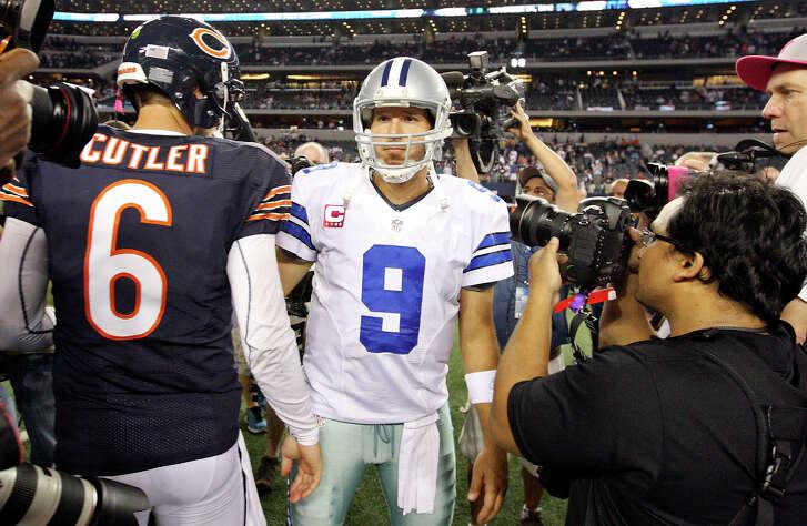 Chicago Bears' Jay Cutler and Dallas Cowboys' Tony Romo meet after the game Monday Oct. 1, 2012 at Cowboys Stadium in Arlington, Tx.  The Bears won 34-18.
