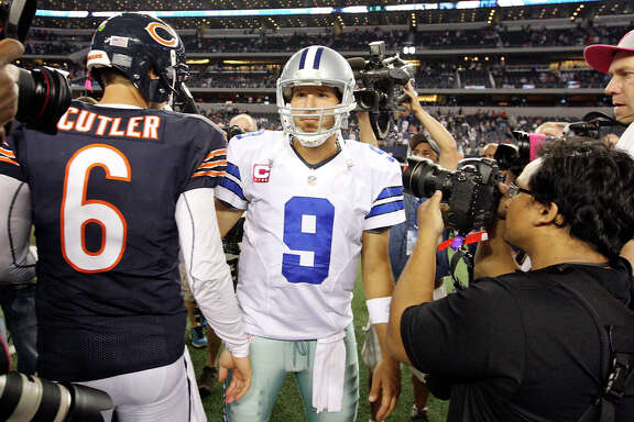 Chicago Bears' Jay Cutler and Dallas Cowboys' Tony Romo meet after the game Monday Oct. 1, 2012 at Cowboys Stadium in Arlington, Tx.  The Bears won 34-18.