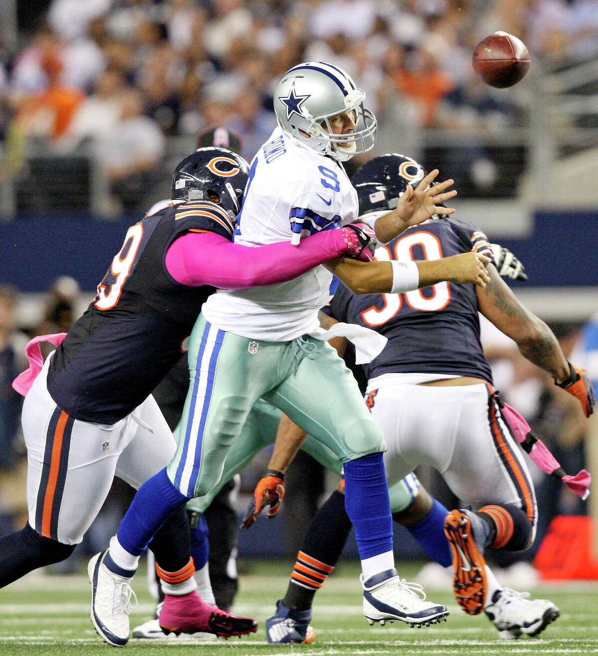 Oct. 1: Dallas Cowboys' Tony Romo is pressured by Chicago Bears' Henry Melton and loses control of the ball during second half action at Cowboys Stadium. Chicago Bears' Lance Briggs ran the ball in for a touchdown on the play. The Bears won 34-18.