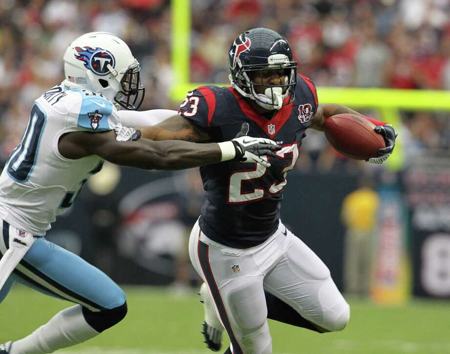 Houston Texans running back Arian Foster (23) gains yardage against Tennessee Titans cornerback Jason McCourty (30) during the first quarter at Reliant Stadium on Sunday, Sept. 30, 2012, in Houston. ( Karen Warren / Houston Chronicle ) Photo: Nick De La Torre / © 2012  Houston Chronicle
