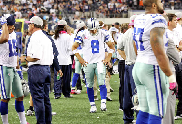 Dallas Cowboys' Tony Romo (center) walks the sidelines during second half action against the Chicago Bears Monday Oct. 1, 2012 at Cowboys Stadium in Arlington, Tx.  The Bears won 34-18. Photo: Edward A. Ornelas, Express-News / © 2012 San Antonio Express-News