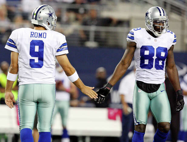 Dallas Cowboys' Tony Romo (left) and Dallas Cowboys' Dez Bryant slap hands after a play during first half action against the Chicago Bears Monday Oct. 1, 2012 at Cowboys Stadium in Arlington, Tx. Photo: Edward A. Ornelas, Express-News / © 2012 San Antonio Express-News