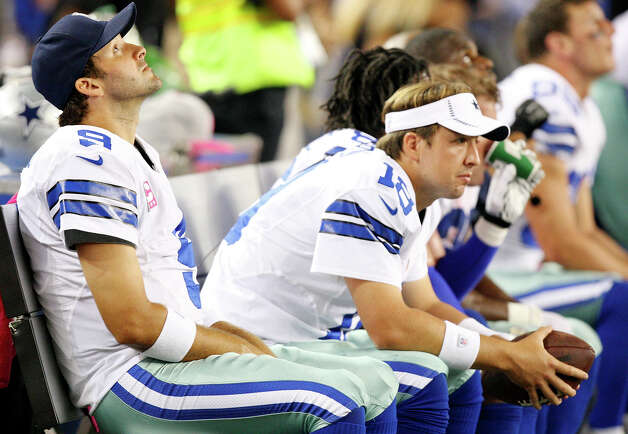 Dallas Cowboys' Tony Romo (from left) teammate Dallas Cowboys' Kyle Orton and others sit on the bench during second half action against the Chicago Bears Monday Oct. 1, 2012 at Cowboys Stadium in Arlington, Tx.  The Bears won 34-18. Photo: Edward A. Ornelas, Express-News / © 2012 San Antonio Express-News