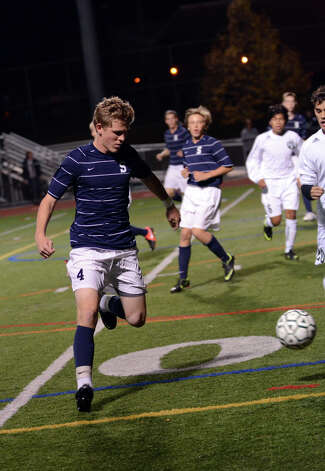Staples' Harry Birch (4) controls the ball during the boys soccer game against Norwalk at Norwalk High School's Testa Field on Monday, Oct. 1, 2012. Photo: Amy Mortensen