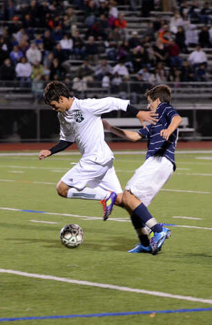 Norwalk's Nacho Navarro (20) controls the ball as Staples' Diego Alanis (9) defends during the boys soccer game at Norwalk High School's Testa Field on Monday, Oct. 1, 2012. Photo: Amy Mortensen / Connecticut Post Freelance