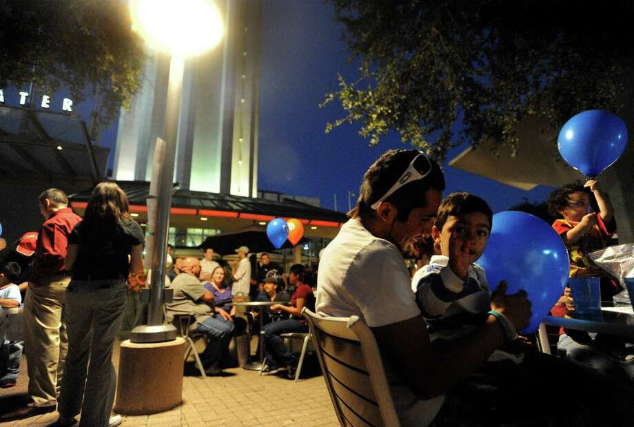 One of our readers, an operator of two businesses, invites residents and tourists to relax and enjoy the area during Downtown Tuesday. Photo: BILLY CALZADA, SAN ANTONIO EXPRESS-NEWS / gcalzada@express-news.net