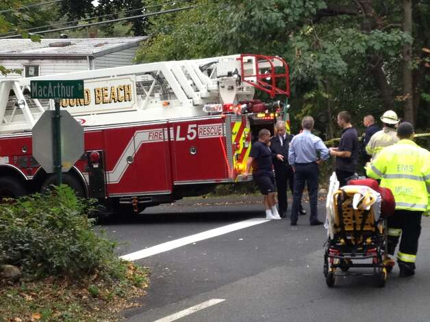 Firefighters in Greenwich, Conn. responded the morning of Tuesday, Oct. 2, 2012 to a structure fire on MacArthur Drive. Photo: Staff Photo