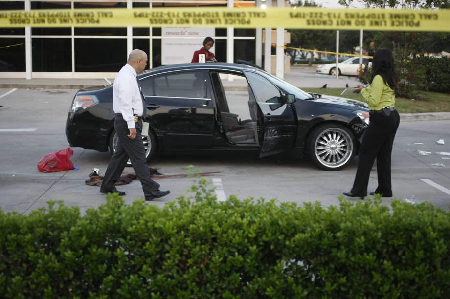 Scene from the shooting investigation in a bank parking lot at the West Sam Houston Tollway at Beechnut, Tuesday morning, Oct. 2, 2012. (Johnny Hanson / Houston Chronicle) Photo: .