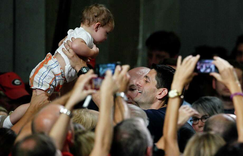 Republican vice presidential candidate, Rep. Paul Ryan, R-Wis., holds a baby during a campaign event at SMT, Inc. in Raleigh, N.C., Wednesday, Aug. 22. (AP Photo/Gerry Broome) Photo: Gerry Broome, Gerry Broome/AP