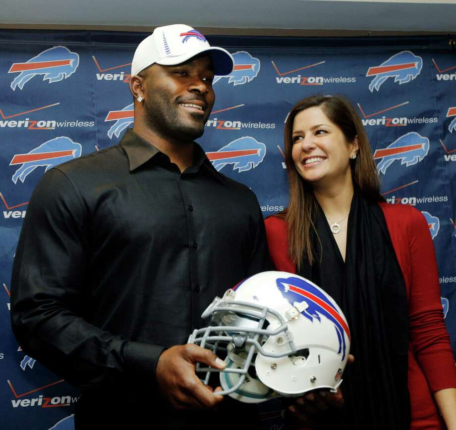 Former Texans defensive star Mario Williams poses for a photo with his fiance' Erin Marzouki after a news conference announcing his signing with the Buffalo Bills. (AP Photo/David Duprey) Photo: David Duprey, Associated Press / AP