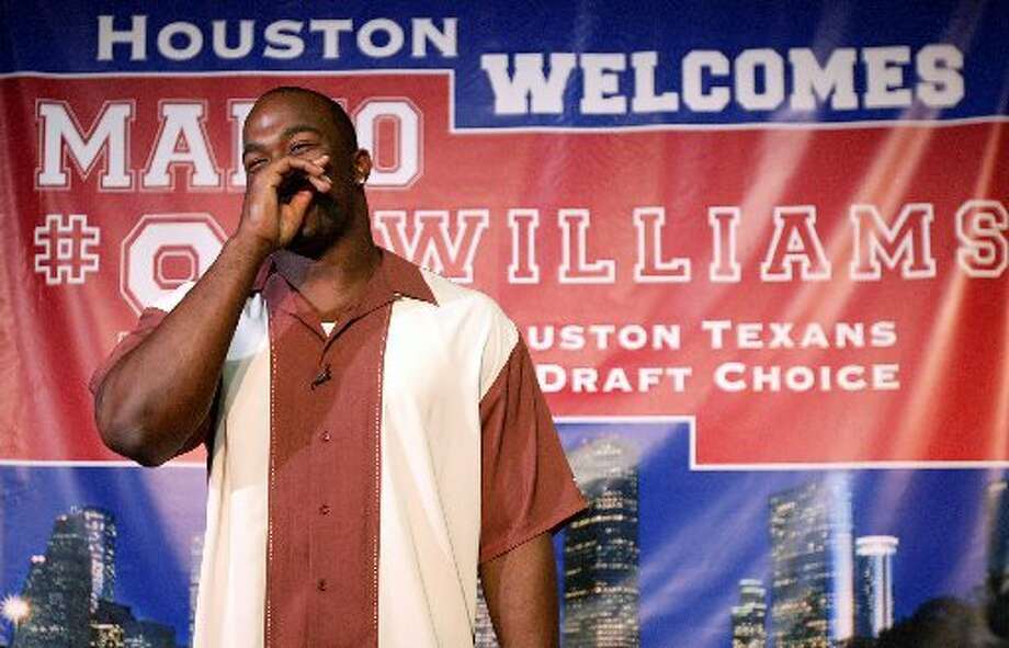Mario Williams is greeted in town. (Jessica Kourkounis / For the Chronicle)