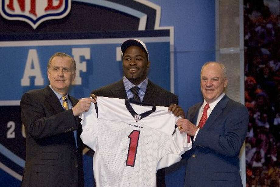 Bob McNair welcomes his No. 1 draft pick. (Brett Coomer / Houston Chronicle)